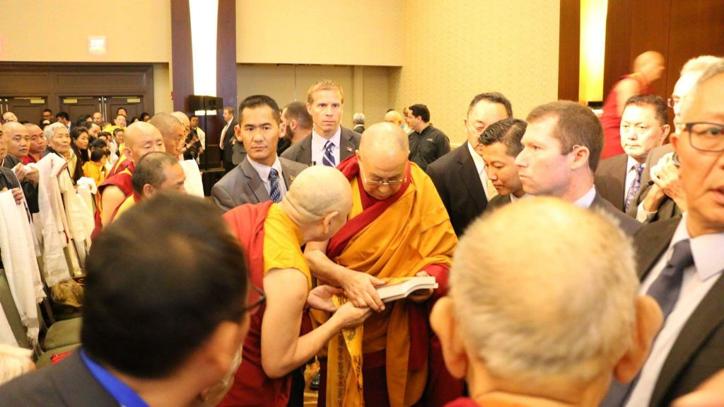 Lama Migmar offering Wisdom Gone Beyond (Heart Sutra) and Awakening to the Noble Truth (Four Noble Truth) Curriculum books to His Holiness the Dalai Lama on Sunday, June 25th at Sheraton Hotel, Boston