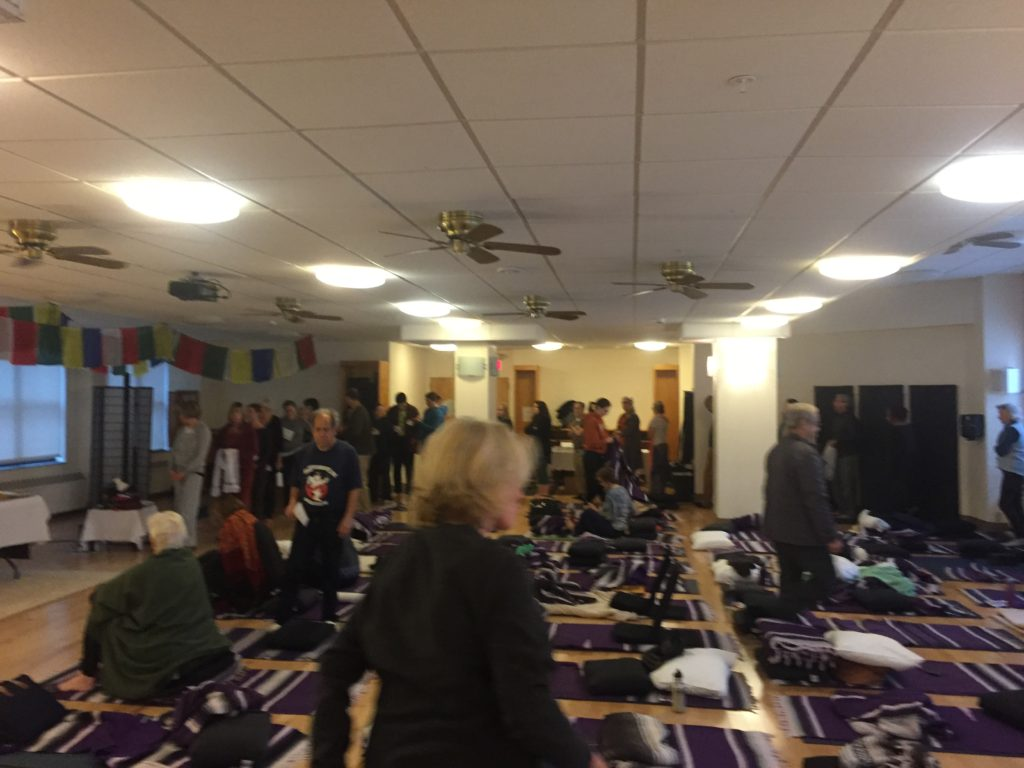 Students are lining to receive blessing during the healing retreat with Lama Migmar at Kripalu
